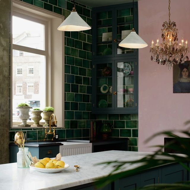 Green kitchen with wall to ceiling tiles