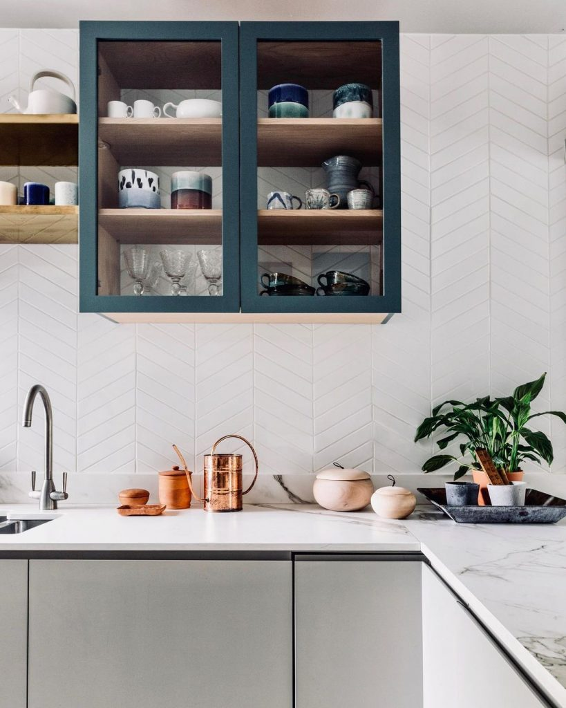 White and green kitchen with herringbone tiles