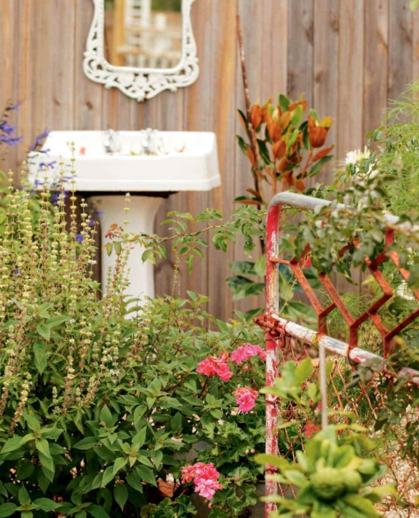 Gardening-with-old-metal-gate-and-sink