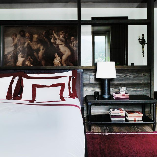 Traditional bedroom design red and dark wood