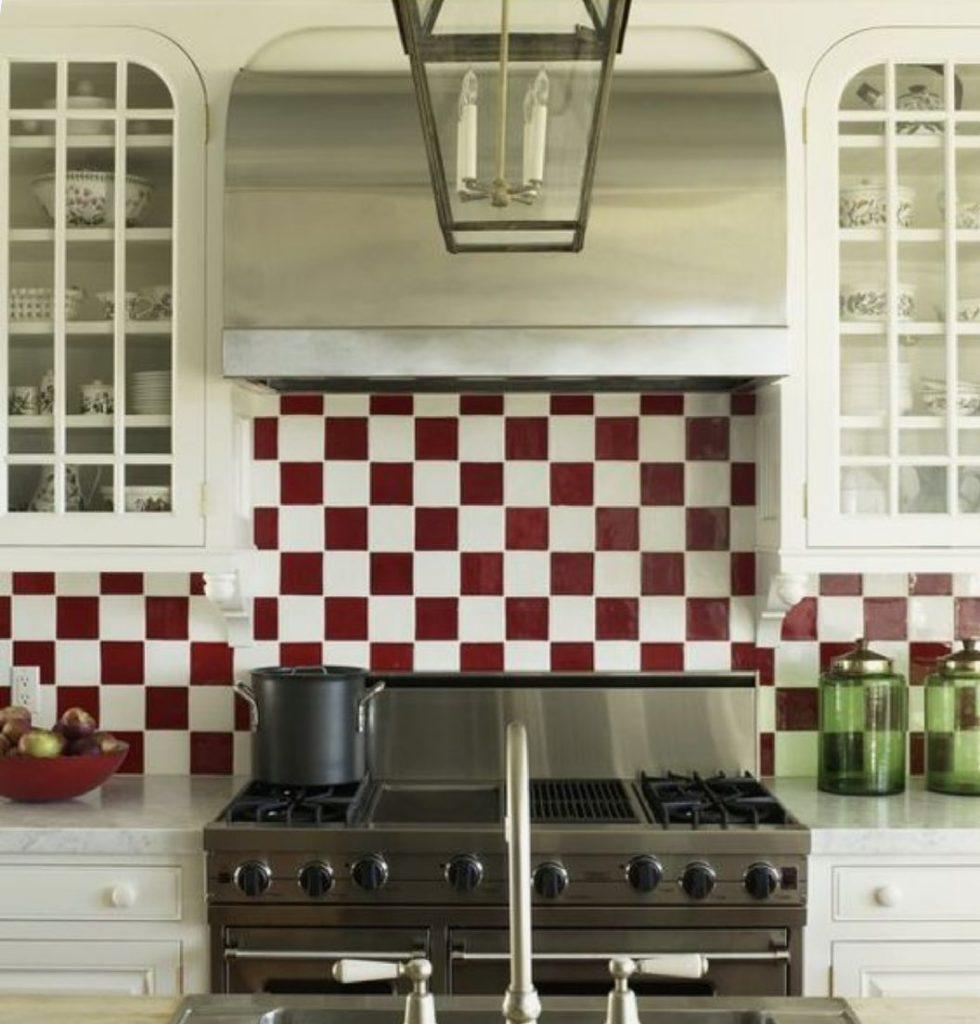 White kitchen red and white tiles splashback