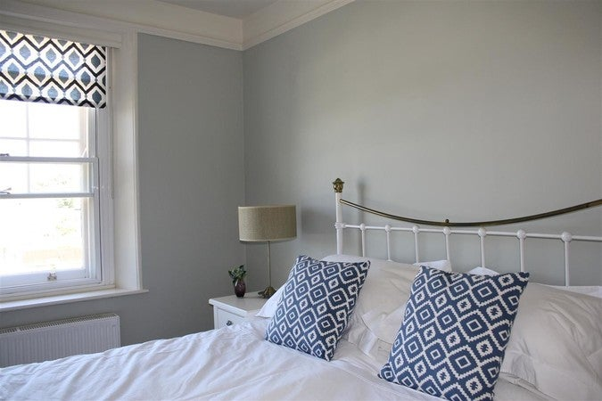 Farrow & Ball Cromarty green painted bedroom walls