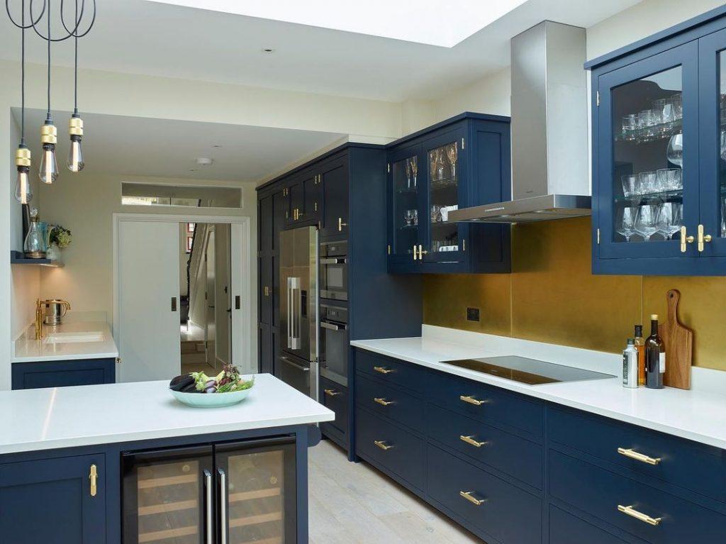Little Greene Paint Basalt navy painted kitchen cabinets and brass hardware