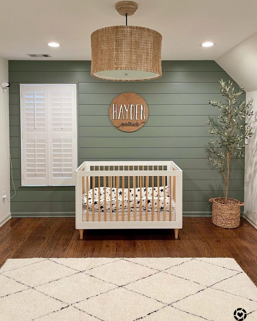 Sherwin Williams Retreat nursery shiplap feature wall