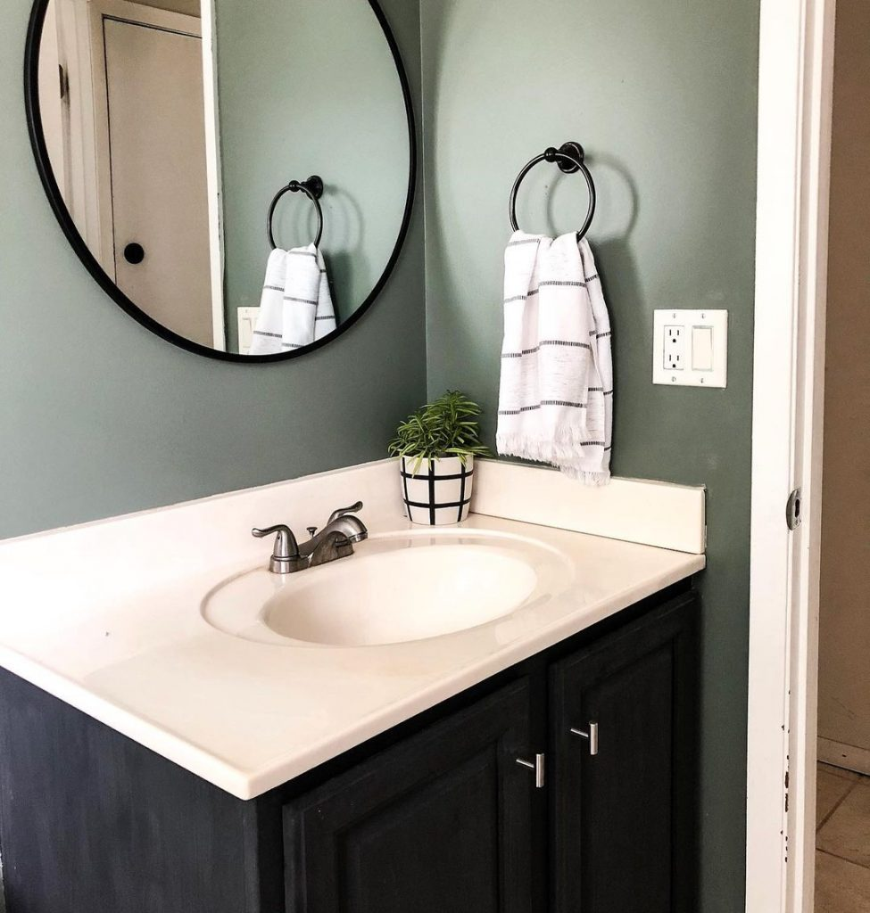 Walls Sherwin Williams Retreat and the vanity in chalked Charcoal