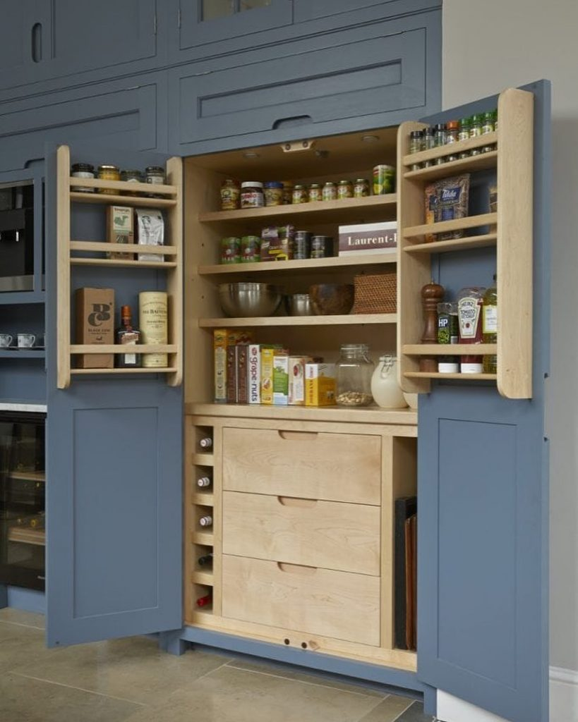 blue and oak kitchen cabinets